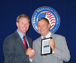 Rohrabacher receiving the True Blue award from FRC President Tony Perkins in 2003