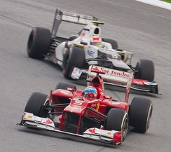 Pérez chasing Alonso for the lead of the 2012 Malaysian Grand Prix, where he achieved his first podium in Formula One.