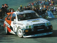 Bruno Thiry steers the Repsol Ford Escort RS Cosworth through the stages of the 1996 Rally Catalunya