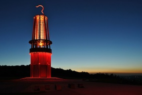 The illuminated, 30 meters high mining lamp memorial by Otto Piene on the spoil tip Halde Rheinpreußen in the north of Moers during the blue hour