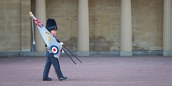 The RAF Regiment Ensign parades with the Queen's Colour