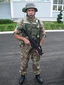 Montenegrin soldier holding a HK MP5