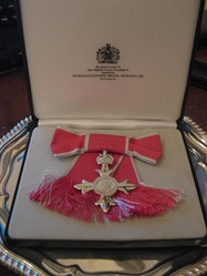 Badge as awarded to a female MBE