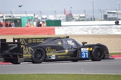 The No. 31 Lotus T128  being driven at the 6 Hours of Silverstone.