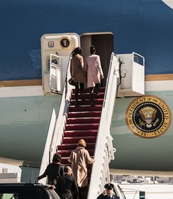 Malia and Sasha Obama prepare to enter Air Force One, Michelle Obama and President Obama behind them, on March 7, 2015.