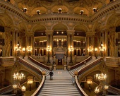 The Grand staircase of the Palais Garnier in Paris, a large ceremonial staircase of white marble with a balustrade of red and green marble