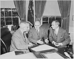 John McCloy meets President Truman and Secretary of State Dean Acheson for talks in the Oval Office.