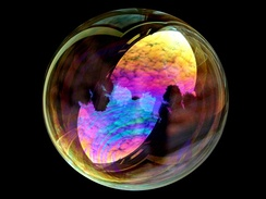 White light interference in a soap bubble. The iridescence is due to thin-film interference.
