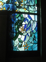 A section of the chapel stained-glass windows by John Piper