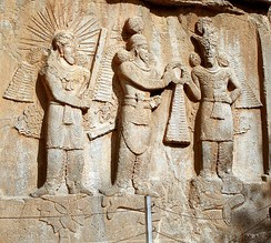 Investiture of Sassanid emperor Shapur II (center) with Mithra (left) and Ahura Mazda (right) at Taq-e Bostan, Iran