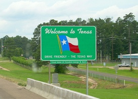 """Welcome to Texas"" road sign"
