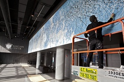 Artist José Parla working on the mural Diary of Brooklyn in the Barclays Center