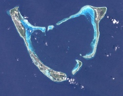 Addu Atoll seen from space. Gan lies at the end of the continuous reef fringing Addu from the west and southwest