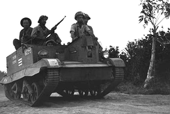 IDF soldiers of the Samson's Foxes unit advance in a captured Egyptian Bren Gun carrier.