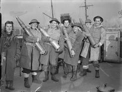 Gunners of HMS Vivien displaying anti-aircraft rounds, 11 November 1940.
