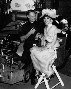 Hepburn with cinematographer Harry Stradling, Jr. on the set of My Fair Lady
