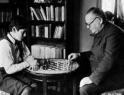 Maxim Litvinov plays chess with his son Misha in 1936