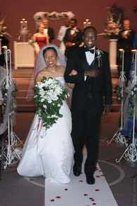 A Filipina bride and Nigerian groom walk down the aisle.