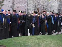 American Academic doctors gather before the commencement exercises at Brigham Young University (April 2008). The American code for academic dress identifies academic doctors with 3 bands of velvet on the sleeve of the doctoral gown.