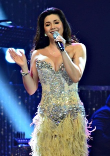 Close-up image of Regine Velasquez singing.