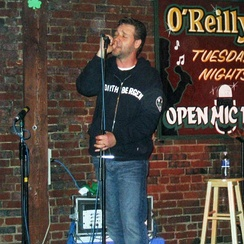 Crowe singing at an open mic night at O'Reilly's Pub in St. John's, Newfoundland. 13 June 2005