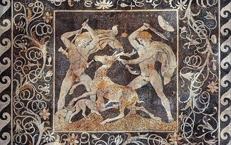 The Stag Hunt Mosaic, c. 300 BC, from Pella; the figure on the right is possibly Alexander the Great due to the date of the mosaic along with the depicted upsweep of his centrally-parted hair (anastole); the figure on the left wielding a double-edged axe (associated with Hephaistos) is perhaps Hephaestion, one of Alexander's loyal companions.