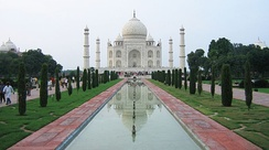 Seen from the side, the Taj Mahal has bilateral symmetry; from the top (in plan), it has fourfold symmetry.