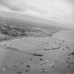 "Overall aerial view of the Mulberry B harbour ""Port Winston"" in September 1944"