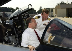 Kaine in an F-14 Tomcat while touring a naval base in 2003