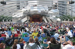 Some of this audience at the Jay Pritzker Pavilion provided their own seating to hear Beethoven's 9th Symphony at the Grant Park Music Festival