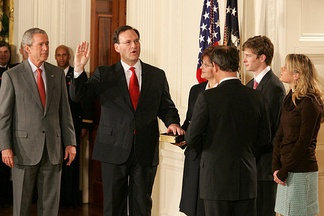 Samuel Alito is sworn in as an Associate Justice by Chief Justice John Roberts in the East Room of the White House on the day after his confirmation, February 1, 2006.