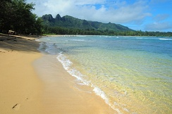 Anahola Bay is a snorkeling and swimming beach with clear pools and a long coral reef. Driving directions in the Kauai Trailblazer guide.