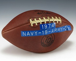 A game ball from the 1974 Army–Navy Game, with the game's final score (Navy 19, Army 0) adhered on with a label.