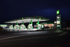 A modern BP filling station on the Kapiti Coast, New Zealand with Wild Bean Cafe and BP Connect, shop built in late 2015