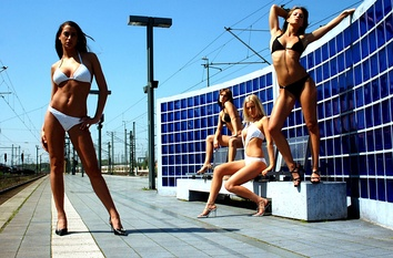 Models in bikinis for a photoshoot, 2011