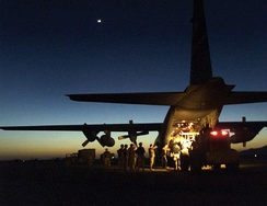 Personnel assigned to the 321st Air Expeditionary Squadron offload supplies from a C-130H Hercules aircraft assigned to the 187th Airlift Squadron, 153d Airlift Wing, Wyoming Air National Guard, at Kandahar, Afghanistan, during Operation Enduring Freedom.