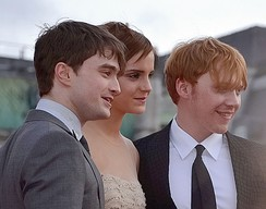 Watson with Daniel Radcliffe (left) and Rupert Grint at the London premiere of Deathly Hallows – Part 2 in July 2011