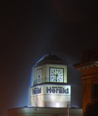 The clock tower of the Herald building in downtown Grand Forks