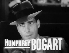 Bogart looking off-camera, with his name on the screen