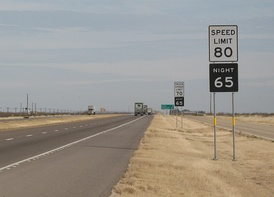 Example of 70 mph truck speed limit sign immediately behind an 80 mph speed limit sign, before truck speed limits were abolished