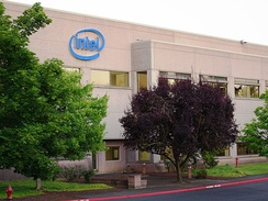 Beige stucco office at Intel Corporation's Hawthorn Farm campus. Building includes the company's logo on the exterior.