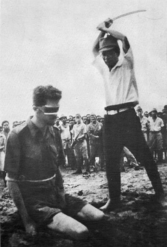 An Australian POW captured in New Guinea, Sgt. Leonard Siffleet, about to be beheaded by a Japanese soldier with a shin guntō sword, 1943