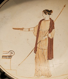 A Kylix (drinking cup) from Attica showing a goddess performing a libation, 470 BC, white ground technique pottery