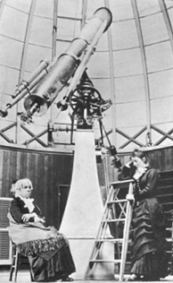 Maria Mitchell (seated) inside the dome of the Vassar College Observatory, with her student Mary Watson Whitney (standing), circa 1877[14]