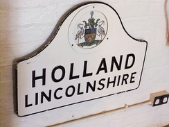Holland sign on display at the Museum of Lincolnshire Life with the Latin motto Labor Ipse Merces (Work is its own reward)