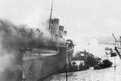 USS Lafayette (AP-53), US-captured French SS Normandie, on fire at New York harbour on 9 February 1942.