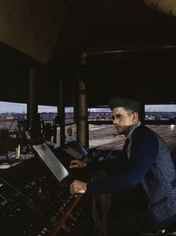 CNW towerman R. W. Mayberry operates the retarders at Proviso Yard in Chicago, Illinois, May 1943.