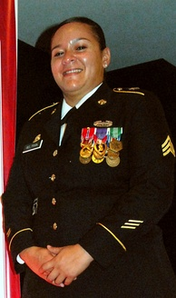 An Army National Guard sergeant in 2012, wearing a Bronze Star Medal with Valor device alongside the Purple Heart.