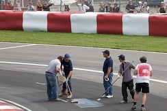 Resurfaced sections of the track began to break up in practice and qualifying and had to be repaired on numerous occasions.