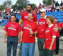 Vlade Divac (rear, center) alongside Crown Prince Alexander II in 2005, at an event for World Heart Day